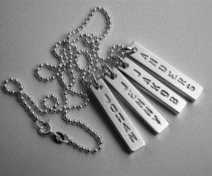 namnbrickor i silver